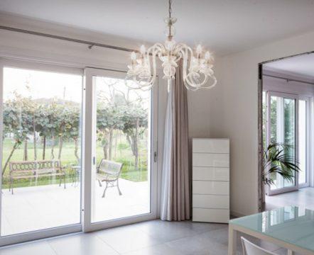 White bathroom with large round window